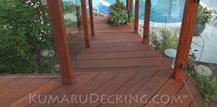 Our Kumaru Decking makes a safe walking surface around the pool.